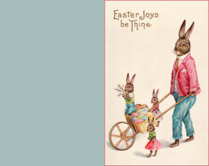 Easter greeting card with bunnies pushing a wheelbarrow.
