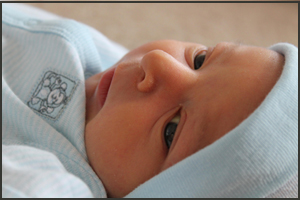 Baby milestones: baby following you with his eyes.