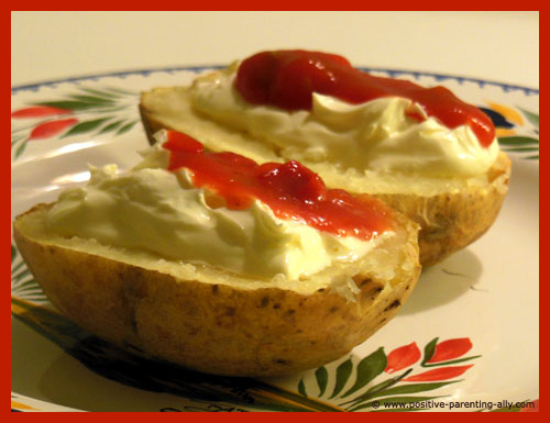 Baked potato with salsa and sour cream""