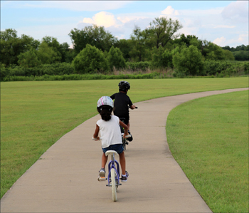 Biking with kids in nature as a healty kids activity.
