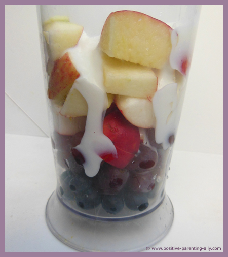 Blending the fruit for the smoothie.