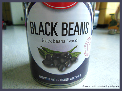 Can of black beans in water for crispy healthy snacks.