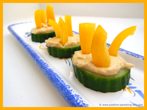 Cucumber hummus discs as an easy snacks for kids.