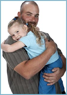Photo of happy father hugging his little girl