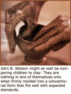 photo of hands molding clay making a cup
