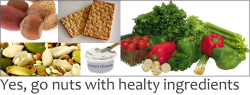 Healthy snack ingredients for kids - nuts, seeds, vegetables, crispbread and cream cheese.