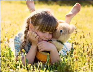 Girl lying in a field happy and at peace.