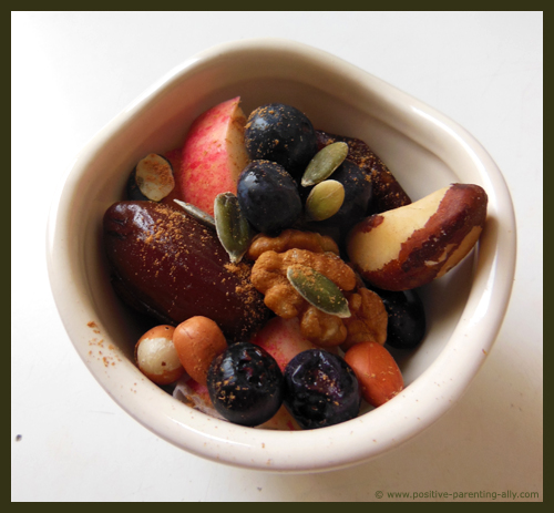 Healthy Halloween snacks for kids: a mix of nuts, berries, fruits and seeds.