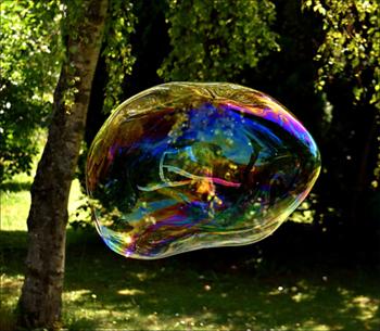 Fun kids activities: Blowing huge soap bubbles in the garden.