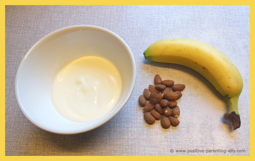 Ingredients for frozen snack treat with frozen banana with yogurt and almonds.
