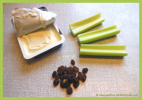 Ingredients for ants on a log with celery, cream cheese and raisins.