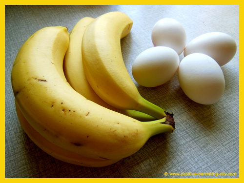 Eggs and bananas as ingredients for banana pancakes.