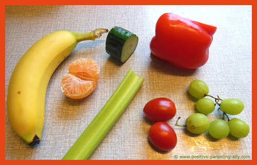 Ingredients for making raw fruit and vegetable kebabs for kids.