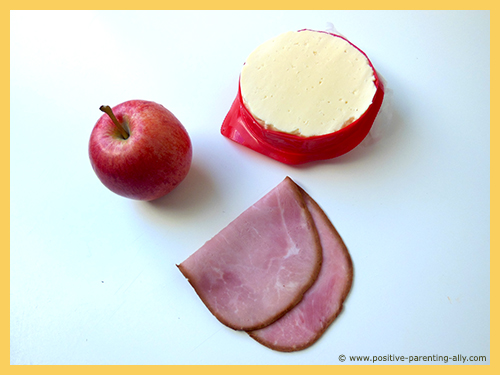 Ingredients for healthy snack for kids: simple apple, cheese and ham snack to make in no time.