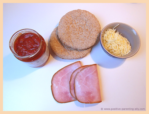 Ingredients for making healthy pizza snack from pita bread.