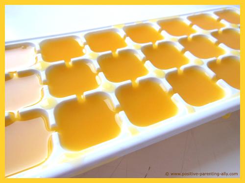 Ice cube tray with orange juice