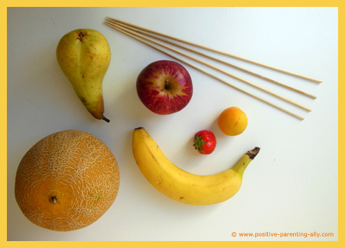 Fruit ingredients for a fruit kebab: melon, pear, apple, strawberry, apricot and banana.