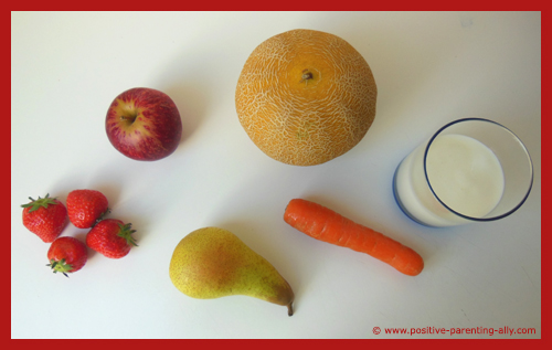 Ingredients for a healthy fruit smoothie with plain yogurt.