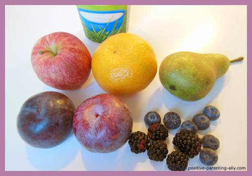 Fruit smoothie ingredients:  apple, pear, orange, plums, blueberries, blackberries.