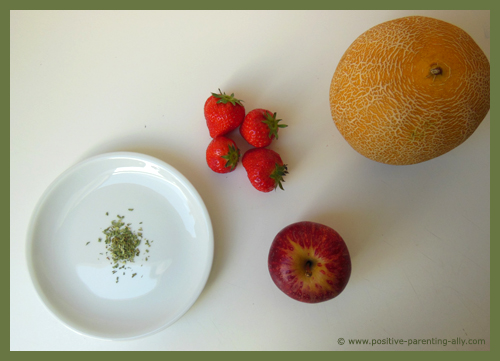 Fruit soup ingredients with strawberry, melon, apple and estragon.
