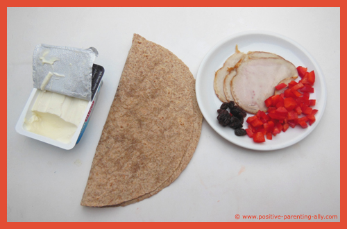 Ingredients for ham pin wheels: ham, tortilla, cream cheese, raisins and bell pepper.