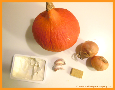 Ingredients for pumpkin soup: pumpkin, onions, garlic, bouillon, lemon.