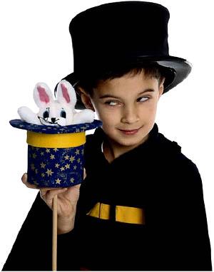Kids magic tricks: Little boy magician with white rabbit.