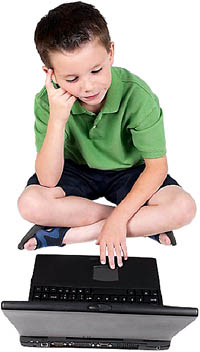 Little boy solving math multiplication games on his pc.