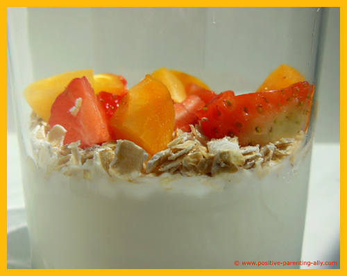 Fruit and oatmeal in plain yogurt. An easy and quick kids snack.