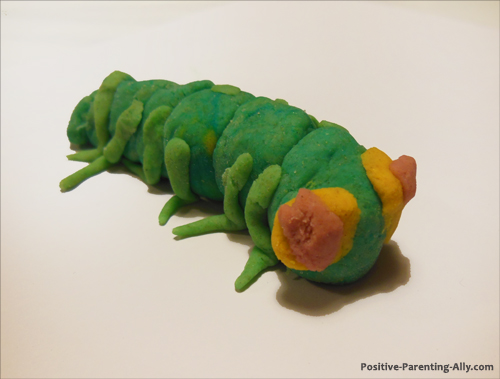Cute green worm or bug made of homemade play doh.