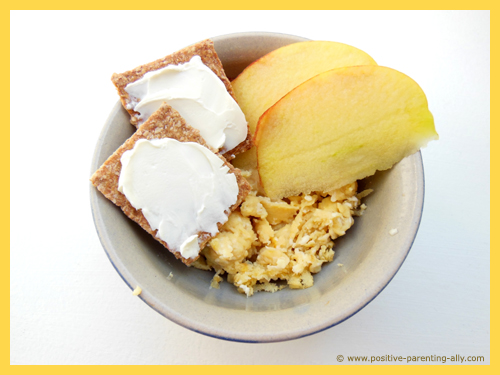 Quick snack for kids with scrambled eggs and apple slices