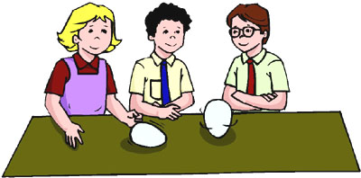 Spinning a raw and a cooked egg as one of the fun science projects for kids to do in the kitchen at home.