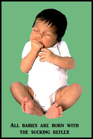 Sleeping infant sucking on hand.
