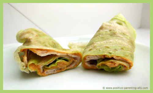 Turkey salad rolls with peanut butter as healthy easy snacks for kids.