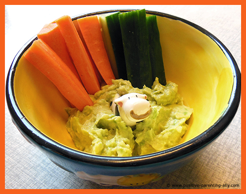 Simple snack recipes for kids to make quickly: Veggie sticks of carrots and cucumber with avocado dip.
