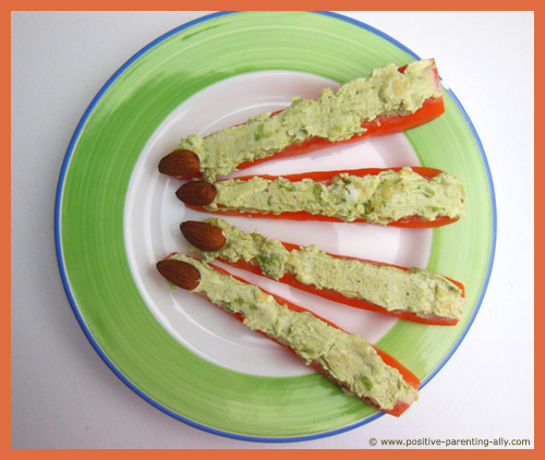 Healthy Halloween finger foods: Green witches' fingers. A really healthy Halloween kids' snack.