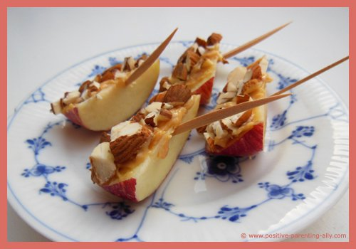 Simple snack recipes for kids: Almond apple boats with peanut butter.
