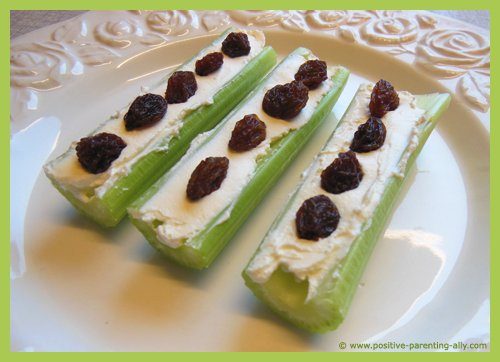 Healthy snack for kids: ants on a log with celery, cream cheese and raisins.