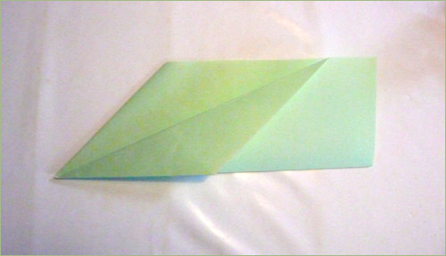 Origami airplane step 4 in paper crafts for kids