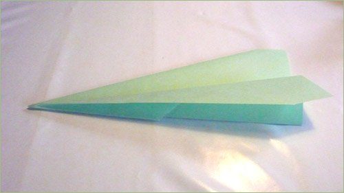 Origami airplane step 6 in paper crafts for kids