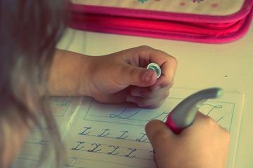 Girl writing and doing homework.