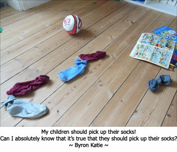 Picture of children's socks on the floor. Byron Katie questioning whether her kids should pick them up.