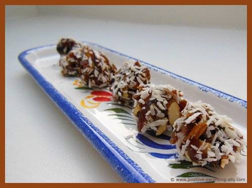 Quick healthy kids snacks: dates with almond and coconut.