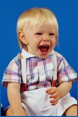 Photo of happy little toddler boy shouting