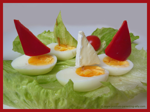 Fancy egg boats with sail for kids as a quick, easy and healthy after school snack.