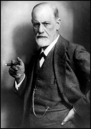 Famous photo of a stern looking Freud holding a cigar.
