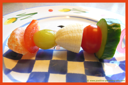 Raw fruit and vegetable kebab for kids as a healthy snack.