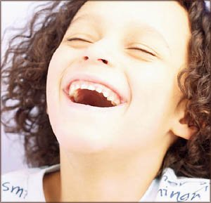 Little girl laughing having a great time.