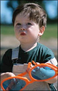 Fun activities for toddlers: Little toddler boy with big sunglasses.