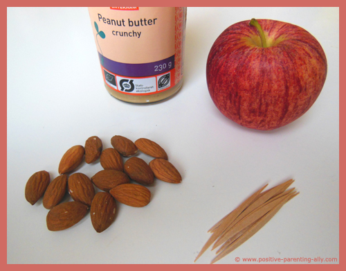 Ingredients for almondy apple boats: Apple, almonds and peanut butter.